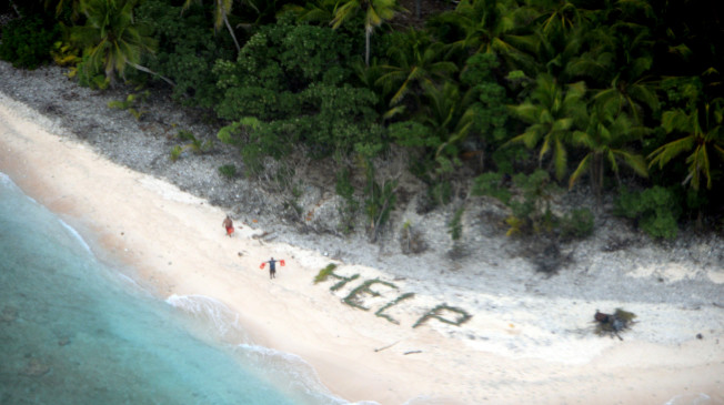 This photo provided by U.S. Navy released April 7, 2016 shows two men waving life jackets and look on as a U.S. Navy P-8A maritime surveillance aircraft discovers them on the uninhabited island of Fanadik.   The three men were back to safety on Thursday, April 7, 2016, three days after going missing.   (U.S. Navy/Ensign John Knight via AP)